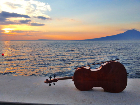Cello at a sunset in Sorrento Coast