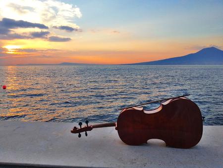 cellos: Cello at a sunset in Sorrento Coast