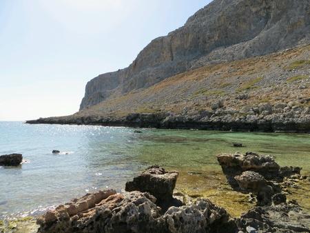 Rhodos beach with a mountain wall Reklamní fotografie
