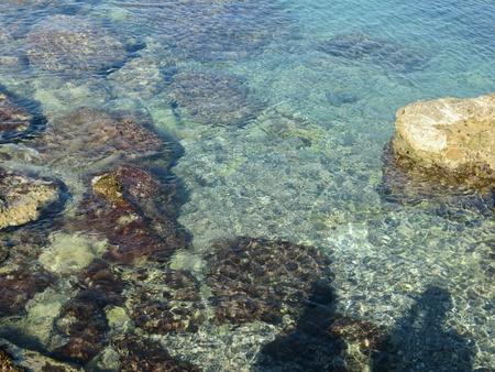 Rhodos beach of rock with a crystalline sea Reklamní fotografie