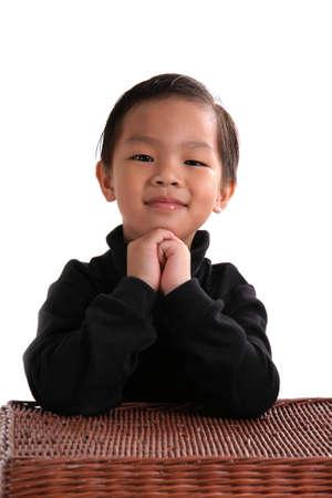 handsome boy praying photo