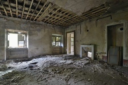 abandoned room: old abandoned room with window and fireplace