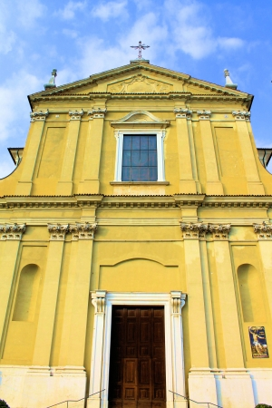 humanistic: facade of yellow church in Italy