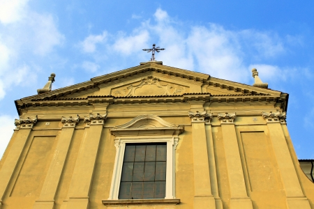 humanistic: particular facade of yellow church in Italy