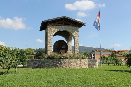 monument to the production of wine and vineyard barrel photo