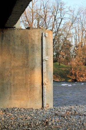 measuring the level of water in the river photo