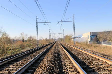 Two sets of railroad tracks run straight and parallel photo