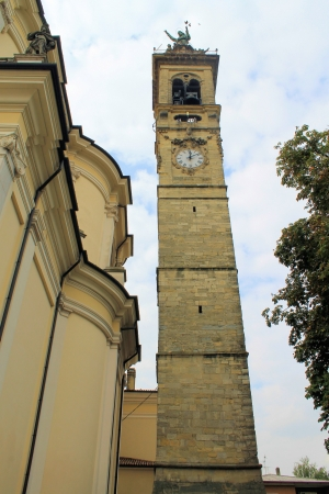 humanistic: bell tower with clock in a small town in northern Italy Stock Photo