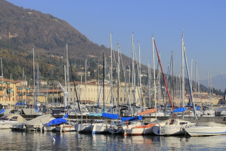 harbor with boats on Lake garda in Italy photo