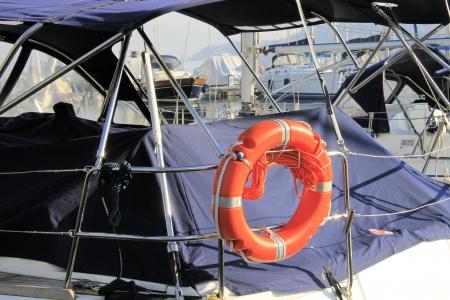 life buoy on boat in a marina  photo