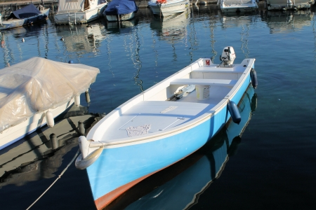 small fishing boat in a harbor on Lake Garda photo