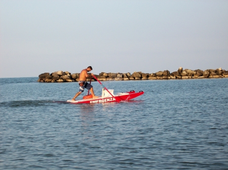 lifeguard rowing his boat photo