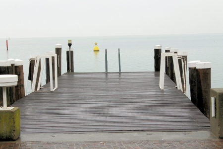 Small jetty in lago di Garda, Italy photo