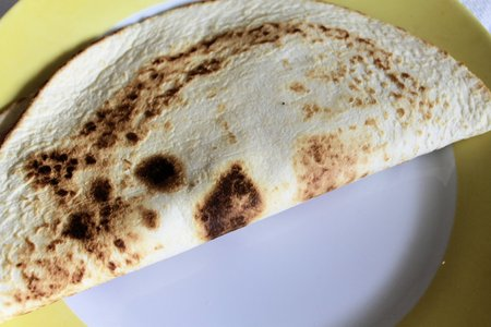 Italian piadina with ham and mozzarella cheese  photo