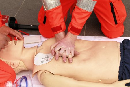 the hands of health care professionals who practice resuscitation photo