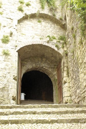 entrace of ancient tunnels of the castle in Italy  photo