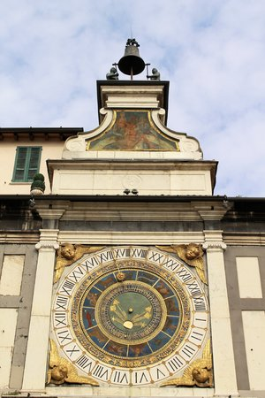 Astronomical clock and bell named  I macc de le ure   the madmen of the hours  in  Brescia  Lombardy - Italy  photo