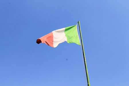 Italian flag blowing in the wind photo