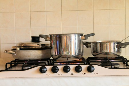 pots on the stove in the kitchen photo
