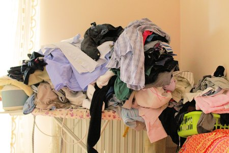stacking of clothes on the ironing board  photo