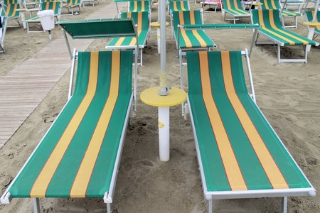 beach with umbrellas and sunbeds in Gatteo in Italy photo