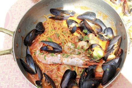 italian cusine: spaghetti with mussels, clams and prawns