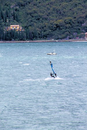 adrenaline rush: windsurfer on Garda lake in Italy