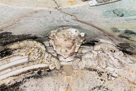 grave site: carved marble angel in an old chapel in Italy