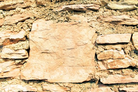 background of ancient stone in the wall photo