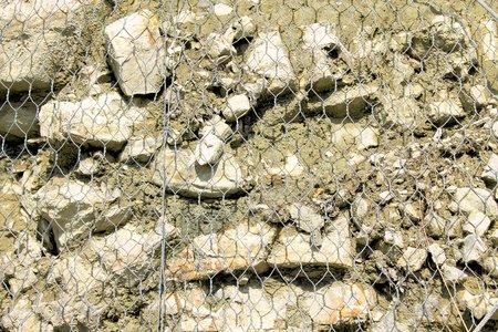 imprisoned: stones imprisoned by wire mesh