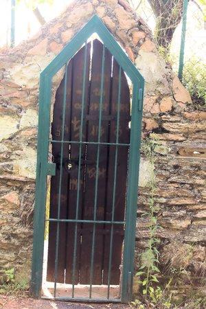 grates: wooden door with iron grates