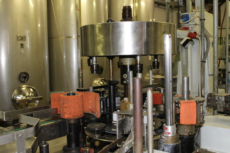 capping: A winery capping and labeling bottle machine