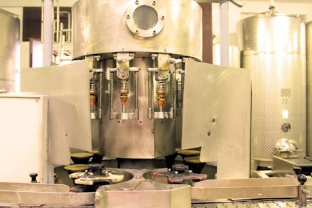 A winery capping and labeling bottle machine photo