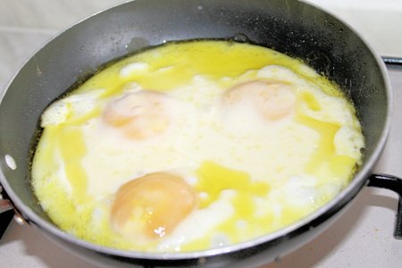 fried eggs: fried eggs in a frying pan Stock Photo