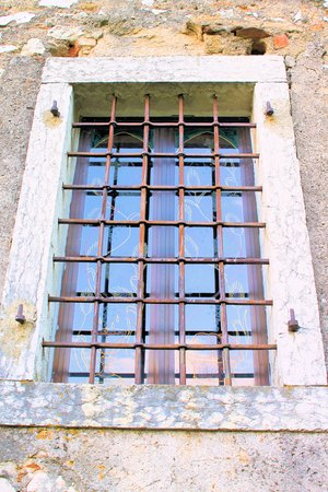 grates: ancient window with iron grates