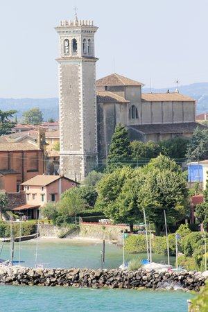 bell tower: church with bell tower  on Garda lake in Italy