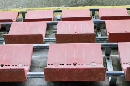 spectators: red seats for spectators in a soccer stadium Stock Photo