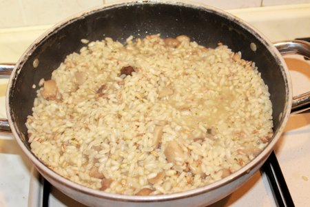 grated parmesan cheese: homemade rice with mushrooms and grated parmesan cheese
