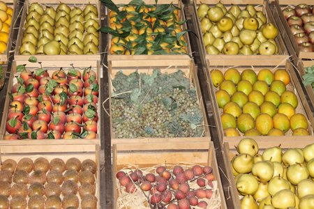 various fruits and vegetables in crates at greengrocer Stock Photo