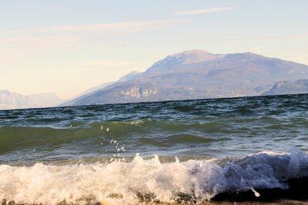 shorebreak: waves on the beach in Sirmione on Garda lake in northern Italy