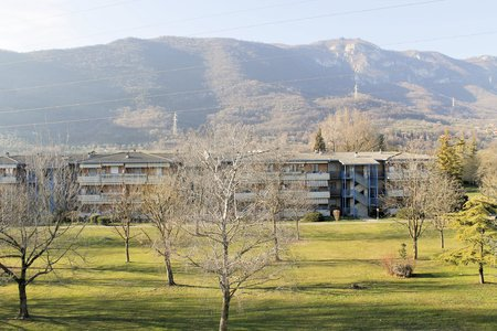 multifamily: view of houses with park and mountains