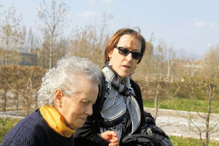 the elderly caregivers: lady who helps elderly woman to walk Stock Photo
