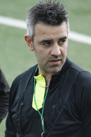 arbitrator: soccer referee in a stadium