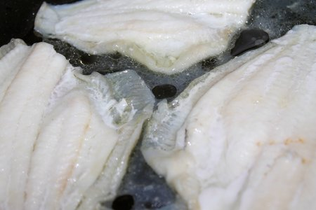 plaice: fillets of plaice in cooking in a pan