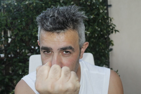 Caucasian man threatening with a fist 版權商用圖片