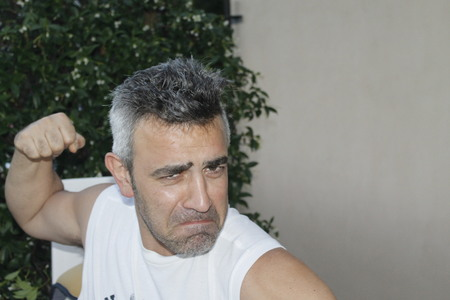 Caucasian man threatening with a fist Reklamní fotografie