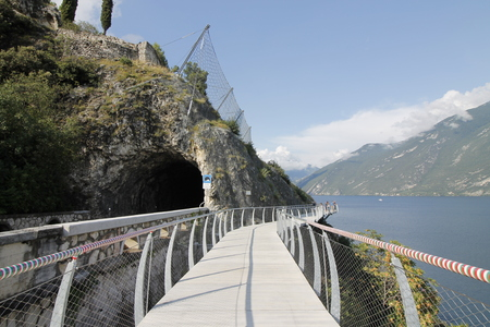 Bicycle road and footpath over Garda lake in Limone sul Garda, Lombardy, Italy Zdjęcie Seryjne