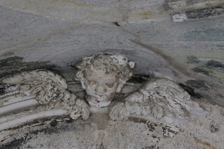 close up of ancient stone statue in an ancient chapel in Italy Stock Photo