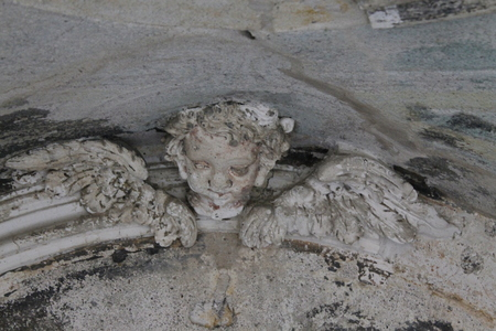 close up of ancient stone statue in an ancient chapel in Italy Standard-Bild
