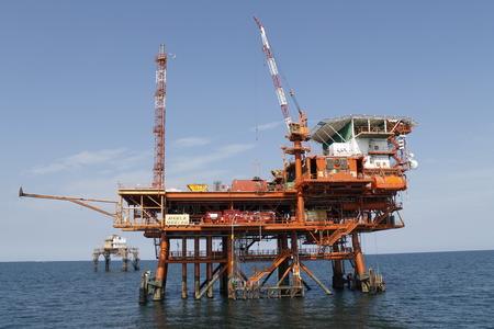 offshore oil and gas drillship, blue ocean background Stock Photo